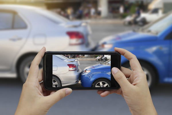 Taking a photo of the car accident